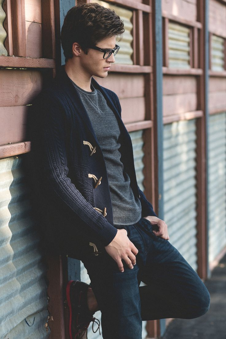 Shop this look for $119:  http://lookastic.com/men/looks/navy-shawl-cardigan-and-charcoal-crew-neck-t-shirt-and-navy-jeans-and-brown-boat-shoes/373  — Navy Shawl Cardigan  — Charcoal Crew-neck T-shirt  — Navy Jeans  — Brown Leather Boat Shoes