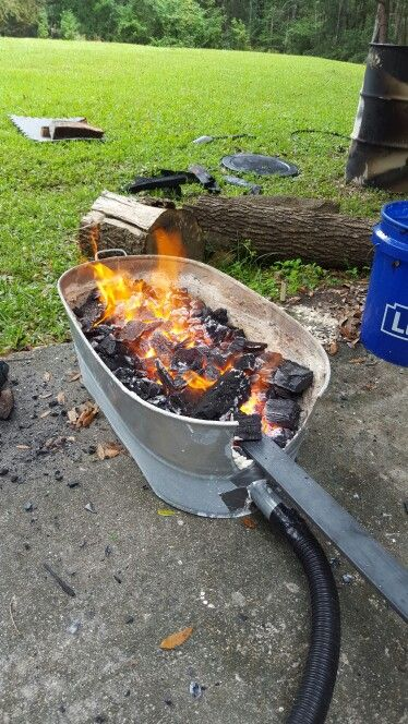 Homemade charcoal forge in action