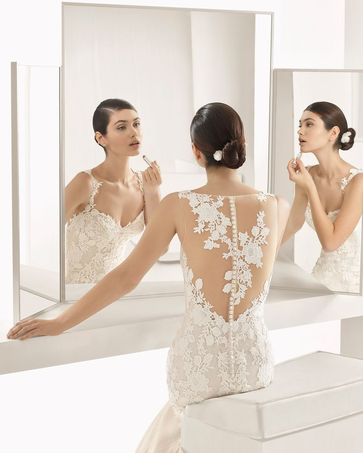 This guipure lace sheath dress exudes sensuality, combining a seductive beaded lace bodice with subtle sheer inserts.