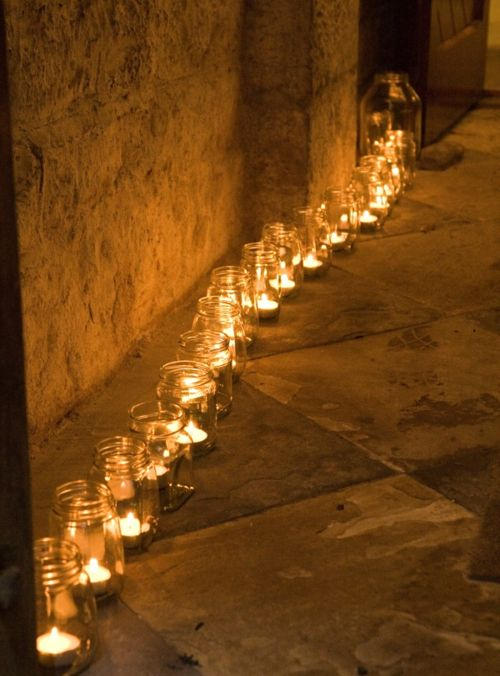 Tea lights in mason jars. Budget friendly way to light a walkway.
