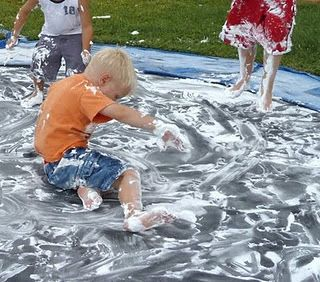 Messy boy party.  Am I brave enough for this? All you need is lots of shaving cream and a tarp!