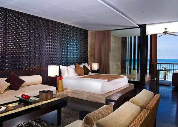 Anantara Seminyak Resort & Spa - beachfront - ocean view ($601 AUD) or pool access rooms ($566 AUD) per nt - no kids club - query if kids can sleep on sofas? - jacuzzi and lounge on veranda. 30 mins from airport.