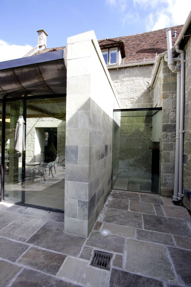 frameless glass link to highly glazed extension on country house