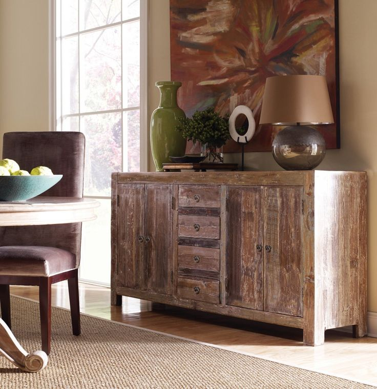 Inspired by classic Vintage Distressed Dining Room Furniture. Our Hampton dining room sideboard crafted from reclaimed teak wood that has been reclaimed from old buildings with a distressed lime wash finished. This farmhouse style buffet sideboard seamlessly combines the warmth and character of beautifully aged woods to the refreshing lines of vintage style cabinet.(http://www.zinhome.com/hampton-rustic-teak-wood-buffet-sideboard/)