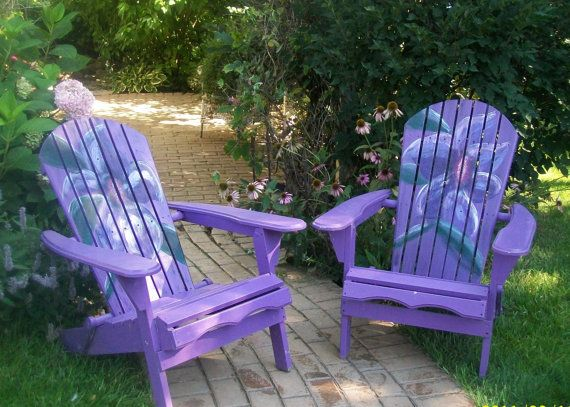 Add fun and color to your garden or porch! These chairs are hand assembled and painted with love. This set is painted in a rich violet with a bold, deep purple flower (with white accents) decorating the entire back. These are truly unique and beautiful pieces.    Each piece is made of solid fir wood. It is primed and painted with exterior paint. The detail is painted in acrylic and sealed with an exterior sealant.