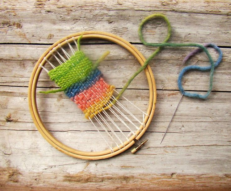 The embroidery hoop weaving loom is nice to hold onto, and gives room for little hands to easily work their threads in and out…in and out…seeing both the front and the back of their work as they go…