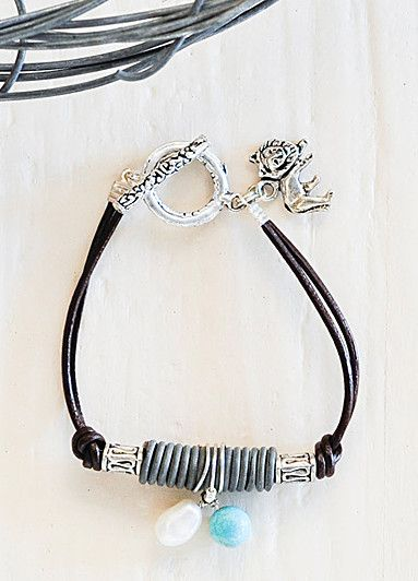 snare wire bracelet made with leather, coiled snare wire, freshwater pearls and torquoise stone with silver spacer beads
