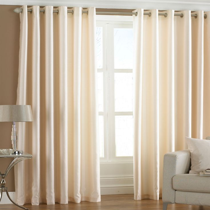 Cream faux silk eyelet curtains that give elegance and style to your home interior #curtains #fauxsilk #creaminteriors #homeinteriors #eyeletcurtains