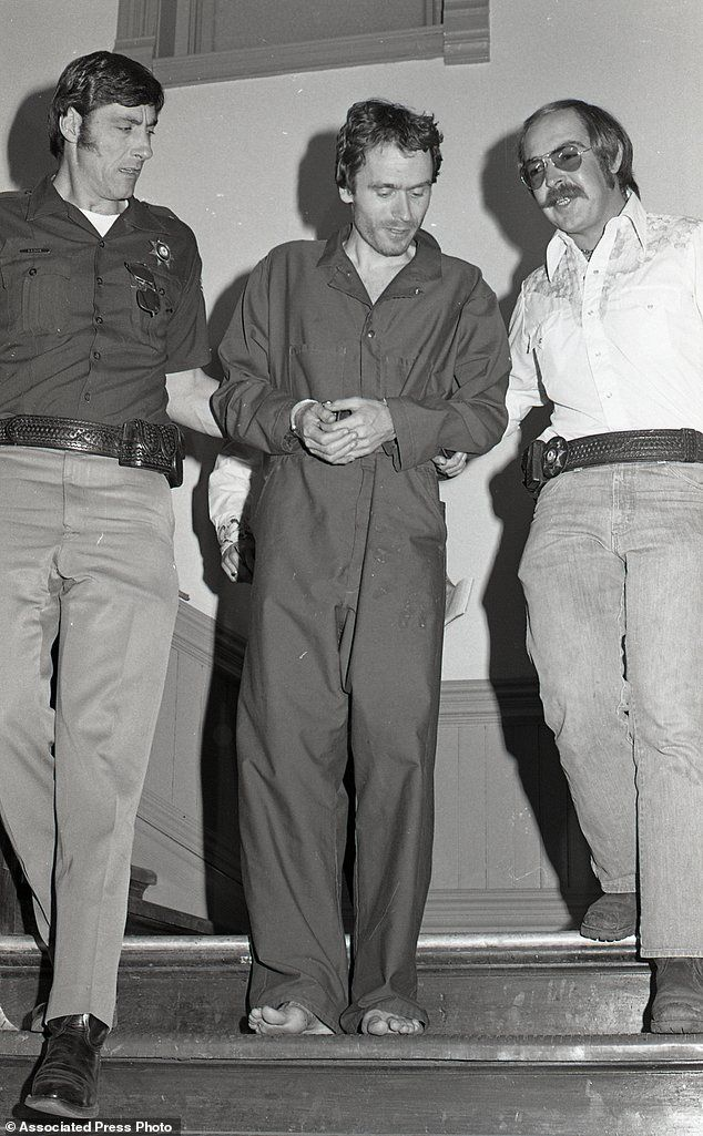 In this 1977 photo serial killer Ted Bundy, center, is escorted out of court in Pitkin County, Colorado. Bundy astonished and terrified the public at the time for being one of the first serial killers that came to the public's attention for not only his demonic killing spree in which he mainly targeted college women, but also his good looks, polished demeanor, and the brazenness with which he abducted women often in broad daylight, once two in one day