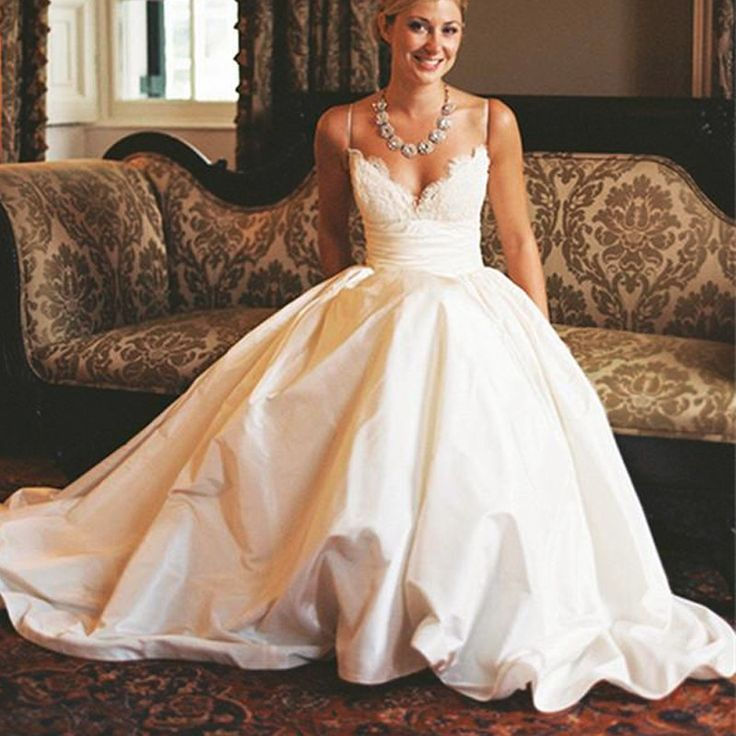 Traditional and sexy. This gorgeous dress has a beautiful lace top with ruched…
