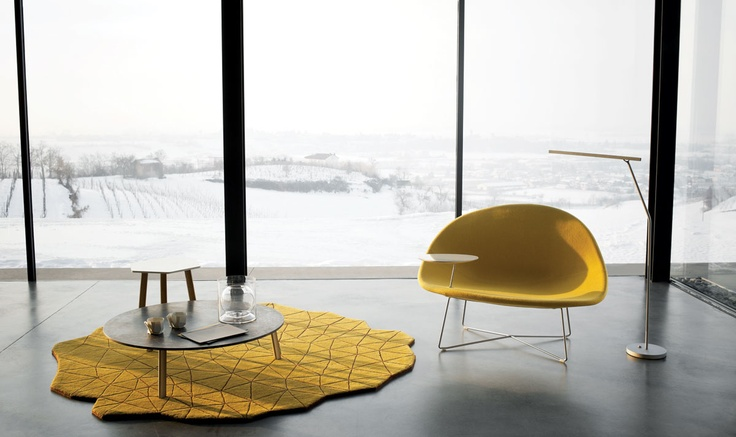 Also love the rug.  Claesson Koivisto Rune's Isola chair with upholstered shell seat, chromed metal base, and optional armrest