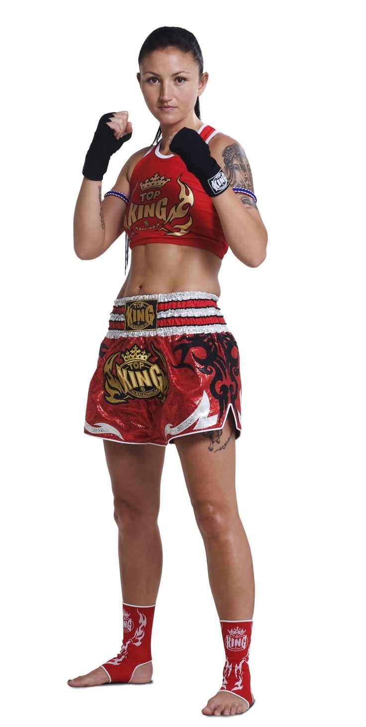 Girl posing in mma gear
