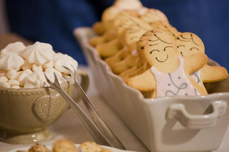Iced biscuits dolls and macaroons.