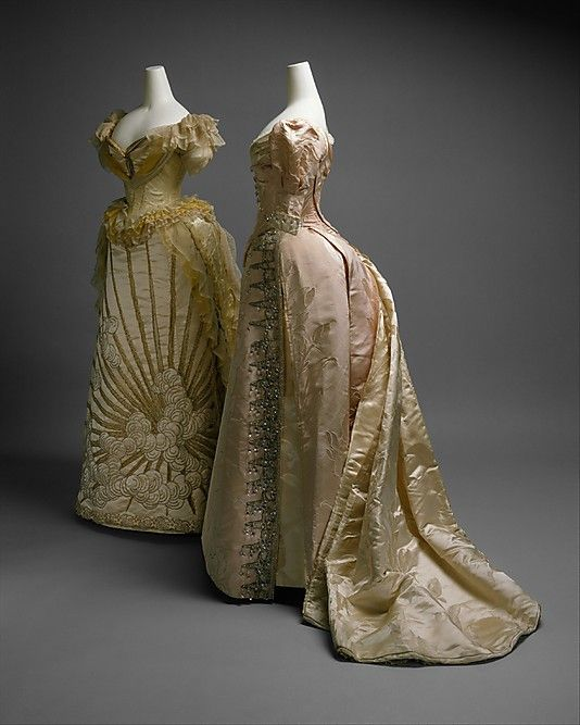 Charles Frederick Worth, 2 Ball Gowns of Silk, Glass Beads, & Metallic Thread. French, ca 1887.