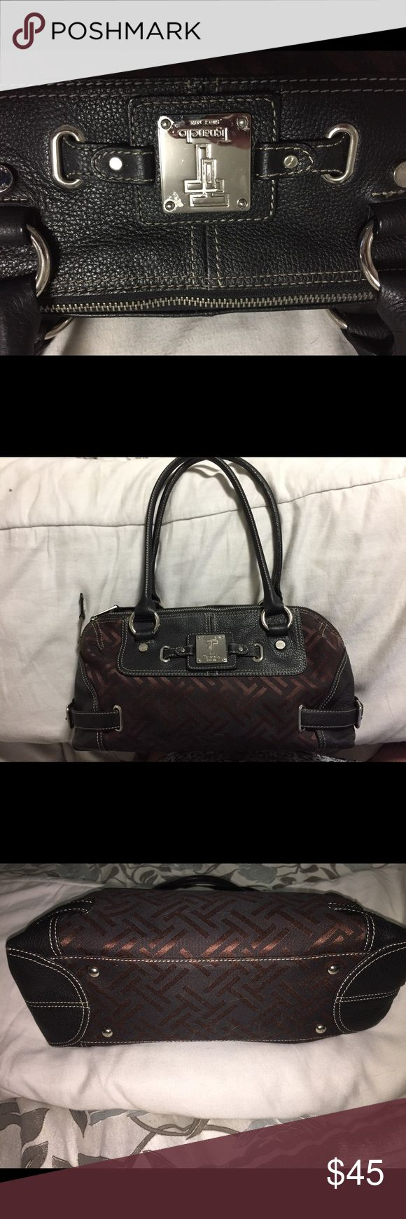 Tignanello handbag 👜 Authentic tignanello handbag 👜 really chic chevron pattern with leather trim! Zippers and pockets galore💋💋💋Excellent condition, this bag goes with everything ❤️❤️❤️👜👜👜👜 Tignanello Bags Shoulder Bags
