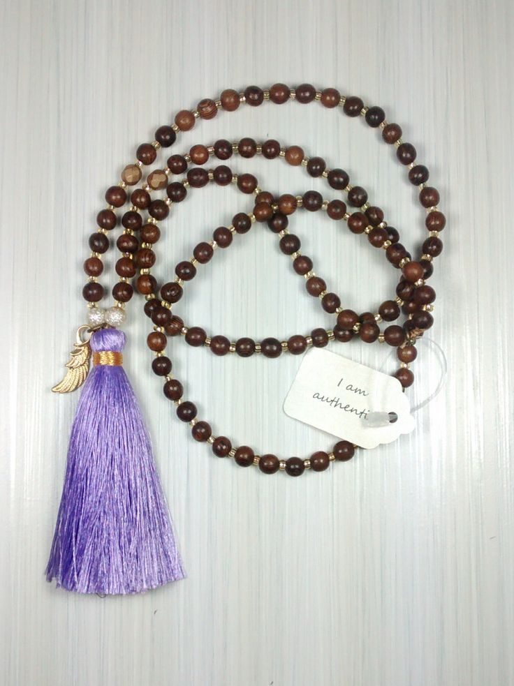 I am Authentic. 108 bead mala necklace. Silk tassel with bronze angel wings. Jewelry for inspired living! by pinksunmalas on Etsy