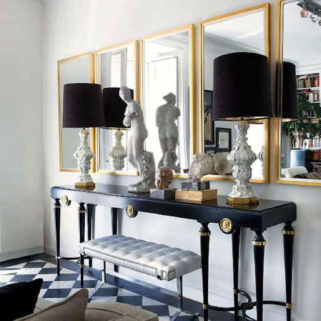Nuevo Estilo Chic Black And Gold Living Room Features French Black And Gold  Console Table, White And Gold Lamps With Black Linen Lamp Shades, ...