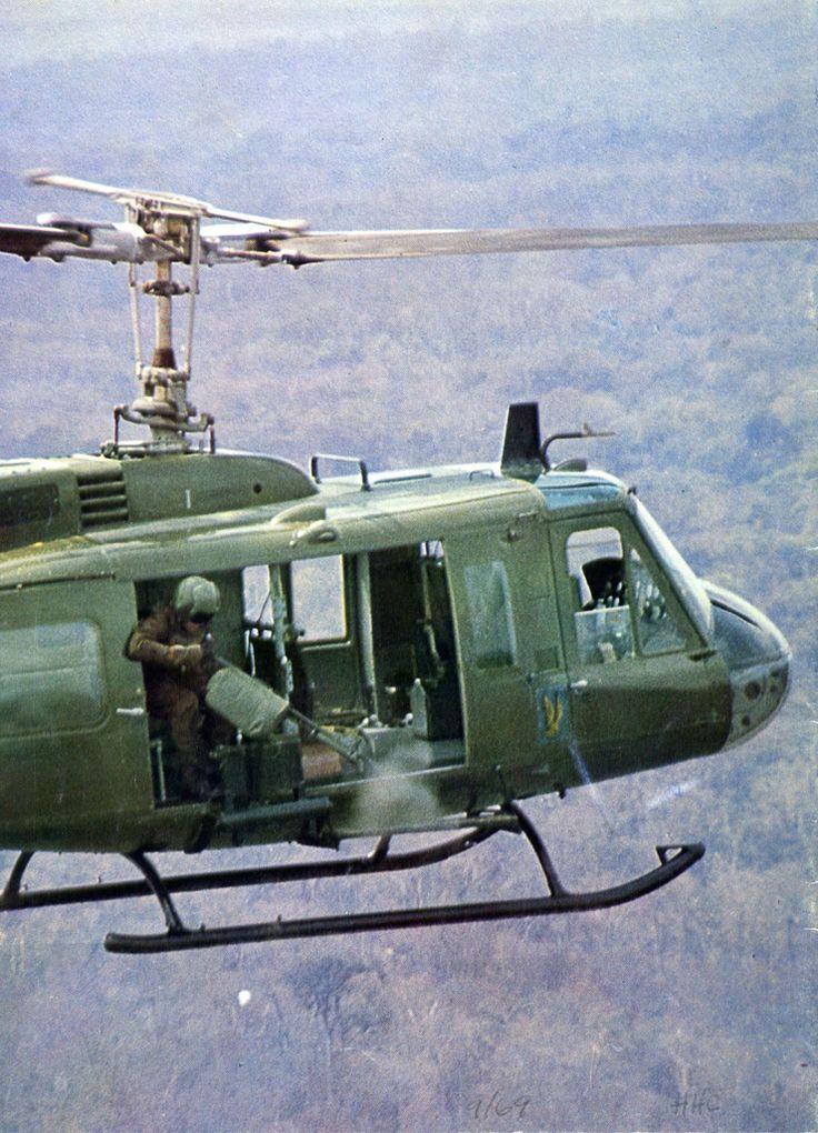 A Huey's door gunner pours a steady stream of lead onto, whatever he's firing at. ~ Vietnam War