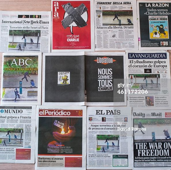 BARCELONA, SPAIN - JANUARY 08: In this Photo Illustration, The front covers of newspapers, 'International New York Times,' 'Ara,' Corriere Della Sera,' 'La Razon,' 'ABC,' 'Liberation,' 'La Vanguardia,' 'El Mundo,' 'El Periodico,' 'El Pais' and 'Daily Mail' are display headlining the terrorist attacks yesterday in Paris on January 8, 2015