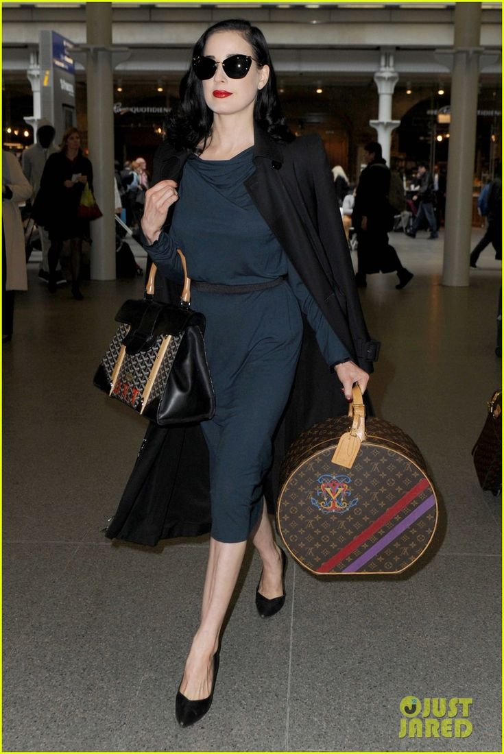 Dita Von Teese travels in style with monogrammed Louis Vuitons.Streetstyle