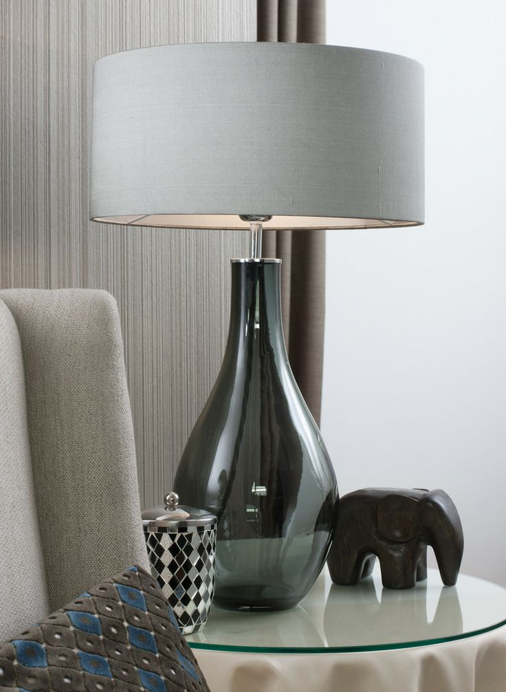 This table lamp is mold blown in melted dark smoke glass this voluptuous shape works beautifully in any interior