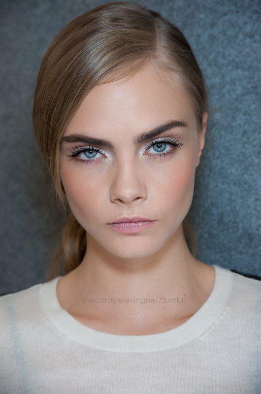 Cara Delevingne // bold brows. white eyeshadow, long lashed, pink lips #beauty #makeup