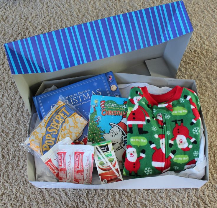 Kids Christmas Eve Box: fill with fun...popcorn, candy cane, hot cocoa, Christmas socks, homemade Christmas pillowcase, etc. etc.