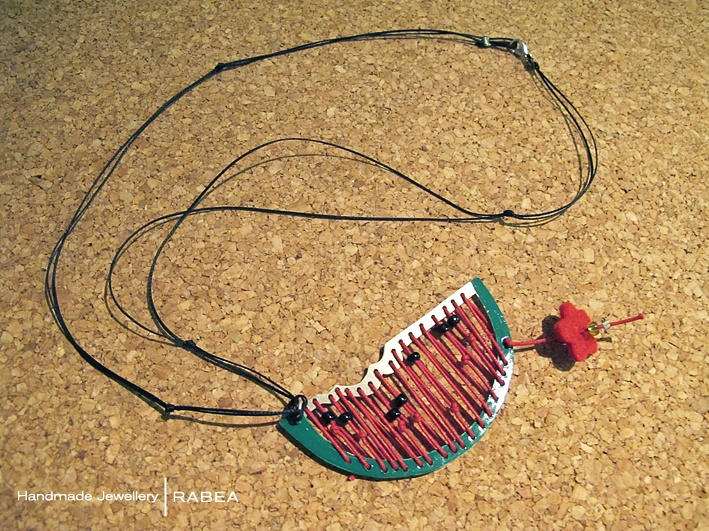 Watermelon necklace from stitched metal