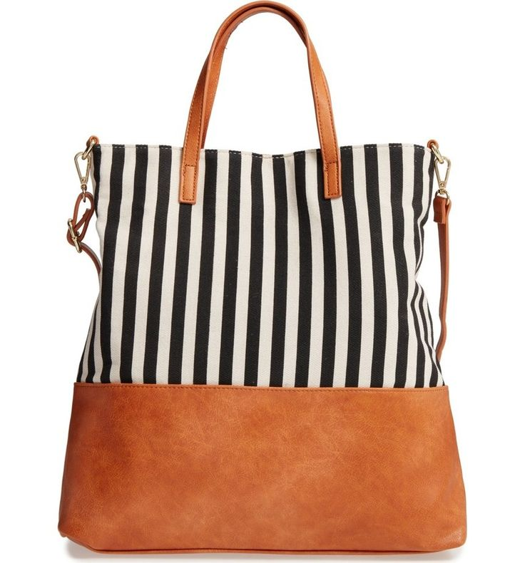 Crisp stripes and faux leather trim make this roomy tote a carefree around-town favorite.