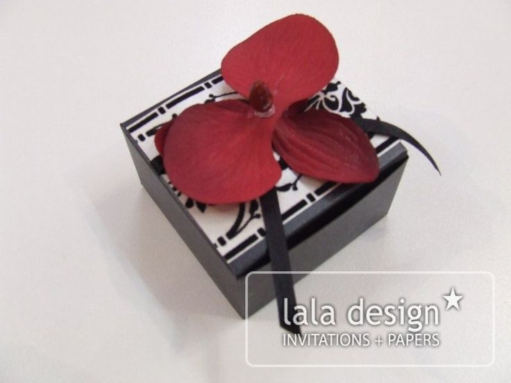 Black and white with red flower box