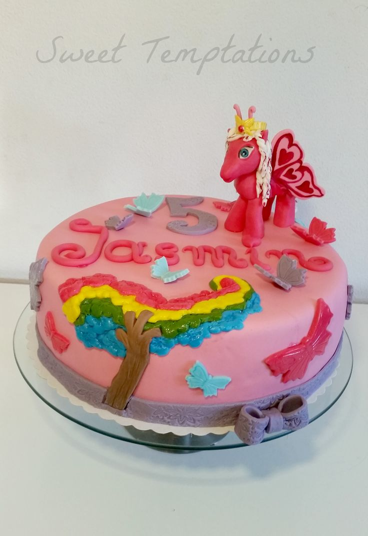 Filly Butterfly Cake - Birthday cake for a big Filly Butterfly fan ;) Cake is filled with vanillasponge and Nutella-cream and raspberries. Pony is made of fondant and gumpaste. Thx for looking ;)