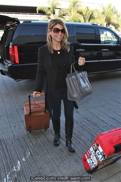 Lori Loughlin and family departs from LAX airport http://www.icelebz.com/events/lori_loughlin_and_family_departs_from_lax_airport/photo2.html
