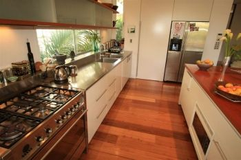 Watsons Bay Accommodation - huge open plan design kitchen which opens up to the dining area and outside patio.