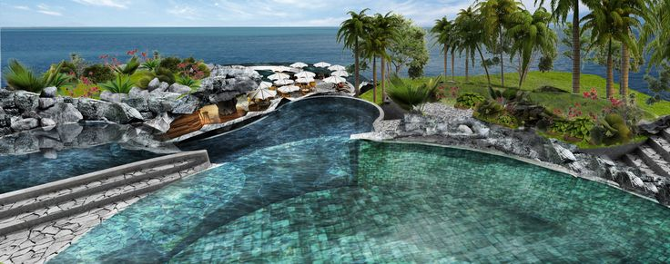 Round shaped #pool towards the #ocean, framed from grey stones in a #charming #landscape. #bali #indonesia