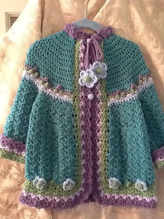 This is a hand crochet sweater with hat foe size 2 to 3.