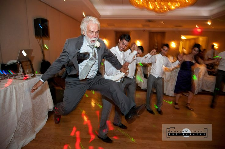 Greek dancing, uncle jumps in the air and almost does the splits, all taking place at Spirale Banquet Toronto Wedding Photography.