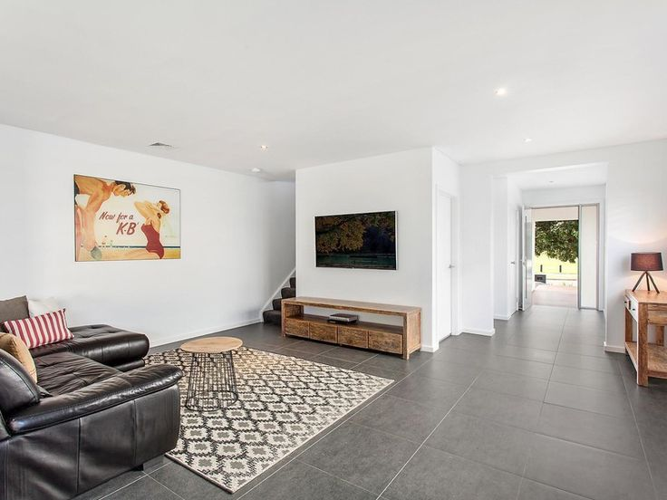 Impressive in its contemporary flowing design, stylish interiors and effortless alfresco entertaining, this as-new residence provides an easycare haven in a sought-after family-friendly address. It is positioned opposite Heffron Park, footsteps to buses.