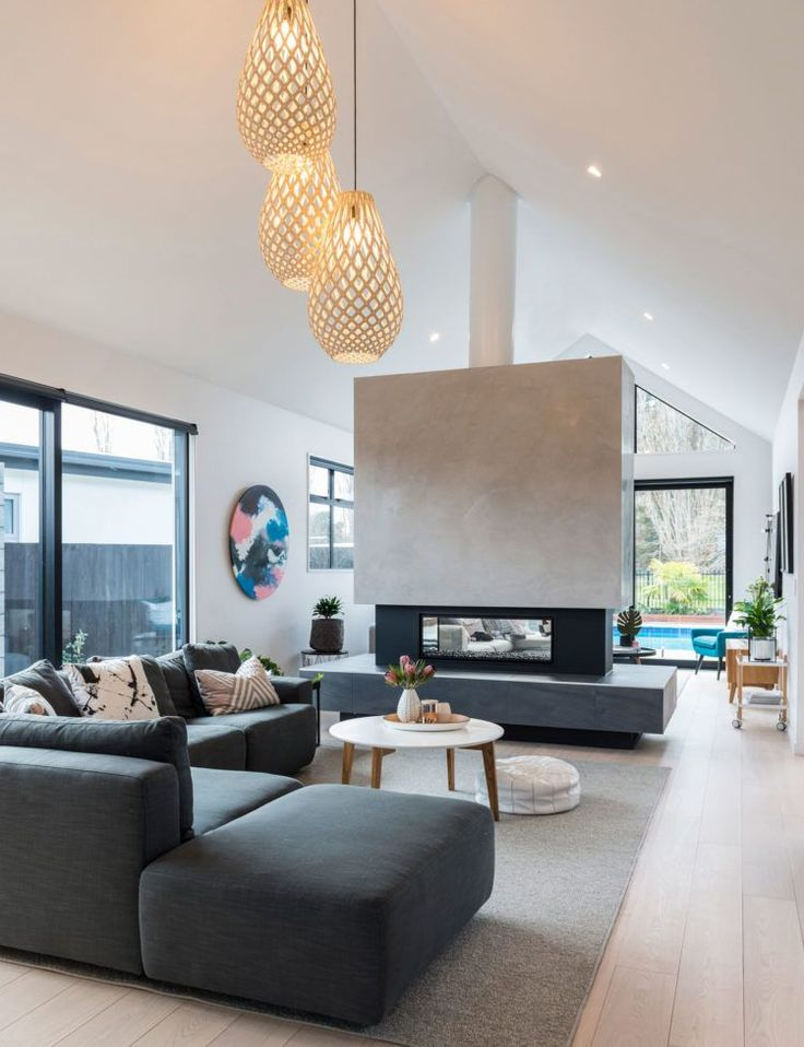 While expecting baby number three this family in New Zealand embarked on an ambitious build and the results are a Scandi-inspired dream.  We love how the freestanding gas fire divides the living area in two!
