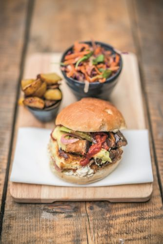 This grilled halloumi burger with chilli ketchup and tahini mayo is a fab barbecue recipe and goes down a treat with both veggies and non-veggies. It's one of our favourite dishes from David and Stephen Flynn's cookbook The World of the Happy Pear.