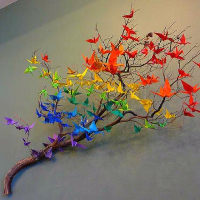 a flock of rainbow origami birds