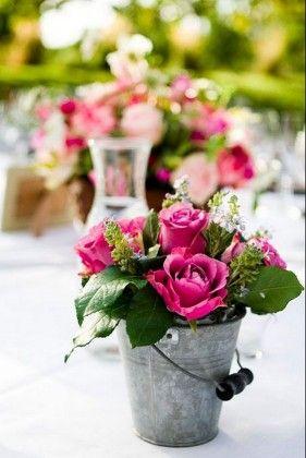 rustic flowers on old bucket wedding centerpiece