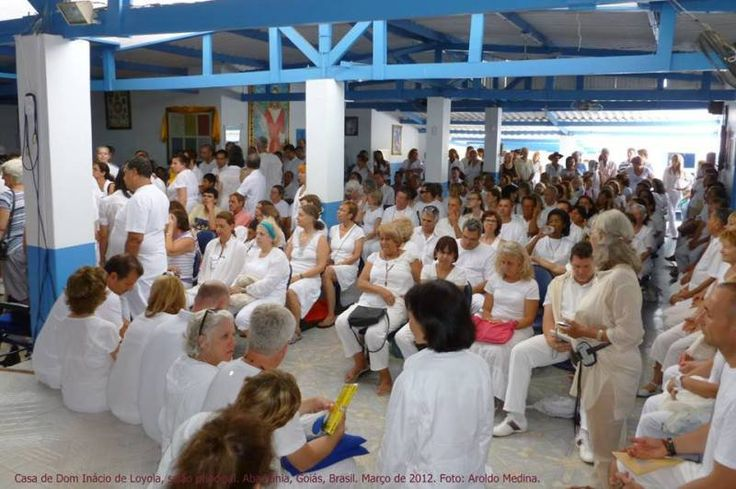 People sitting together and praying in the main hall at The Casa  before passing in front of Joao  #JohnofGod #CasadeDomInacio #energyhealing #faithhealing #entities  #mainhall