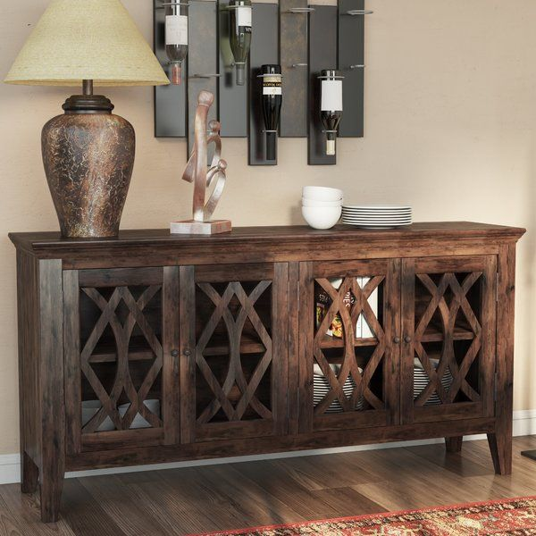 Featuring a light brown mango wood design and stylish cutout details, this eye-catching sideboard lends a rustic touch to any space. Set it in the dining room to keep serveware corralled in style, or let it be a stage for framed photos and burnished accents in the den.