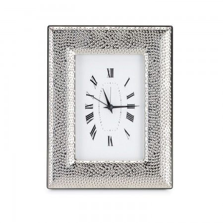 Ornate white clock with sterling silver border is the perfect décor accessory for the home.