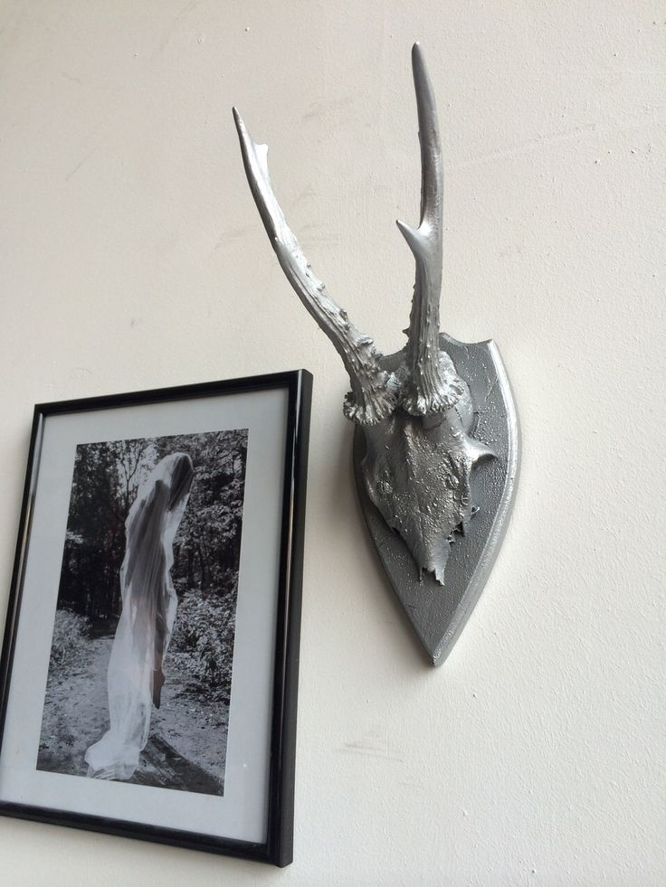 silver metallic style decoration decorantlers old antlers painted and made to new and modern trendy decoration