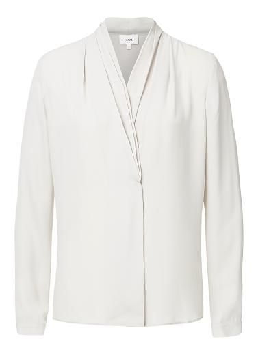 Polyester Crepe Soft Collar Shirt. Comfortable fitting silhouette features a v-neckline with draped cross over front, long sleeves and dipped hem in a sheer fabrication. Available in various colours as shown.