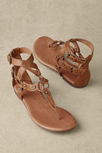 In a classic gladiator influenced style, our Alethea Sandals feature antiqued gold hardware and rivets.