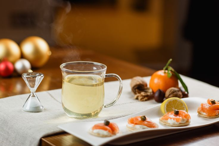 Glass infuser mug and blinis, our delicate green teas pair beautifully with smoked salmon.