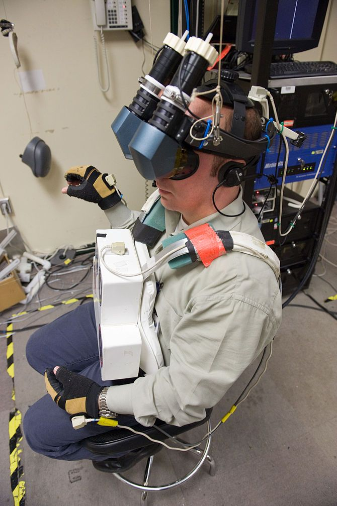 NASA astronaut Garrett Reisman uses virtual reality hardware to rehearse some of his duties prior to a mission to the International Space Station. (Photo credit: Wikipedia)