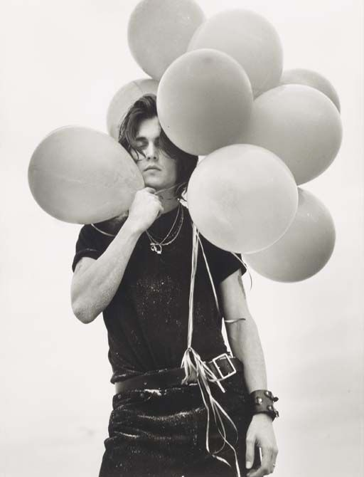 Johnny Depp with balloons by Bruce Weber.  I love the juxtaposition of airy and baddass.